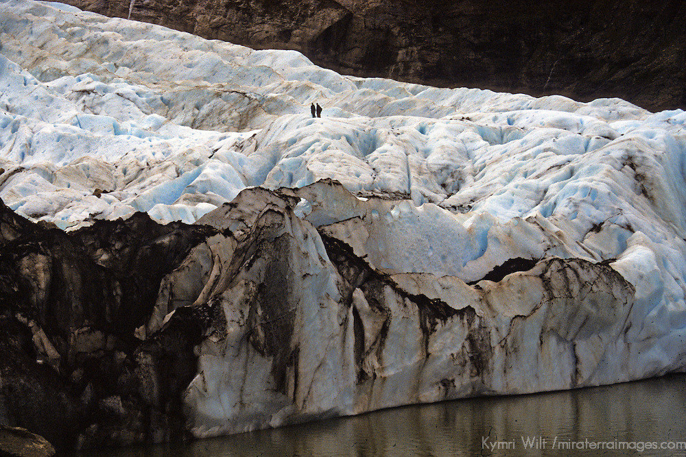Americas, South America. Latin America, Chile, Patagonia. Two small human figures give scale to the size of the glacier.
