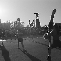 Eight years after the country declared its independence, in 1991,  from the Soviet Union a statue of Lenin looks over Ala-Too Square, formerly Lenin Square, in the capital city of Bishkek during a gymnastic display as part of National Childrens Day celebrations,  Kyrgyzstan.