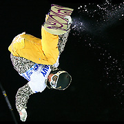 SHOT 1/25/08 7:05:54 PM - Australian snowboarder Torah Bright of Cooma, Australia gets inverted high over the deck of the superpipe during the Snowboard Superpipe Finals Friday January 25, 2008 at Winter X Games Twelve in Aspen, Co. at Buttermilk Mountain. Bright finished second in the event winning a silver medal with a score of 92.66 losing to Gretchen Bleiler (93.33). The 12th annual winter action sports competition features athletes from across the globe competing for medals and prize money is skiing, snowboarding and snowmobile. Numerous events were broadcast live and seen in more than 120 countries. The event will remain in Aspen, Co. through 2010..(Photo by Marc Piscotty / © 2008)