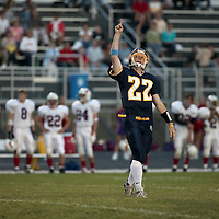 Senior Co-Captain Quarterback Zach Vanek points to Heaven after completing a touchdown pass against Red Wing on Friday, September 10, 2004.  Vanek's brother Nate, was recently killed in a car accident in which his middle brother Christian was driving.