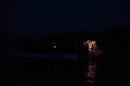 Refugees from Afghanistan and Syria are spotted by volunteer helpers as they reach at dusk the shores of Lesbos near Skala Sikaminias, Greece on 05<br /> November, 2015. Lesbos, the Greek vacation island in the Aegean Sea between Turkey and Greece, faces massive refugee flows from the Middle East countries.