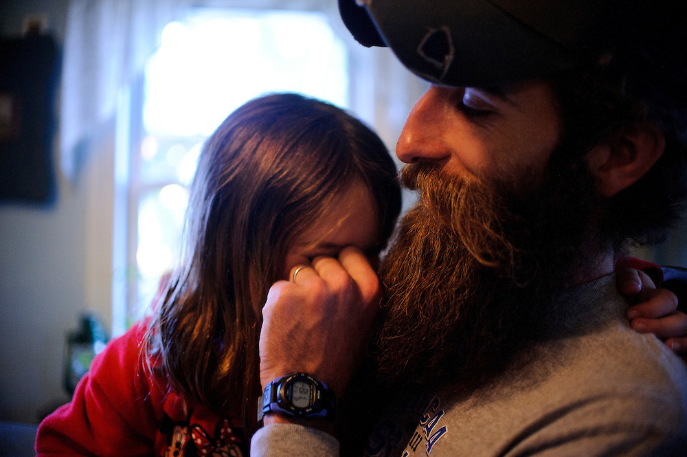photo by Matt Roth.Wednesday, April 11, 2012..Ron Shriver shares a moment with his daughter Rory, 6, after dinner Wednesday, April 11, 2012...Ron Shriver grew up on a large farm house in Pleasant Valley, Maryland, a small township outside Westminster. After his lease was up, he moved back to his parent's home with his two children Rory and Miles, living temporarily in their basement before graduating from McDaniel College in May. After tossing his graduation cap, he and his children will drive cross country to meet up with his wife who has been working on her graduate degree in Alaska. ..Ron Shriver is a retired marine staff sergeant. He is also the first in his family to attend college, thanks to the New G.I. Bill. His wife, a fellow retired Marine, is finishing up graduate school in Alaska. After Ron gets his undergraduate degree from McDaniel College in May, he plans to drive to Alaska with is two children Rory, 6, and Miles, 5. For the move Ron got rid of most of his family's belongings, and after his lease was up, he and his children moved back into his parent's farmhouse.