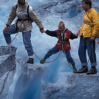 Europe, Norway, Line of climbers ascend blue ice on Nigardsbreen Glacier in Jostedalsbreen National Park