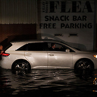 Good Samaritans help push a car out of flood waters after it tried to drive down Washington Street following flash flooding in Worcester, Massachusetts on October 21, 2016.  Flash flooding in the area left many motorists stranded and closed down parts of route I-290.  Photo Copyright Matthew Healey<br /> <br /> (FREELANCE SUBMISSION)