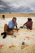 Pleistocene human footprints: Willandra Lakes in southeastern Australia..Bond university Australian studies professor Steve Webb works on the footprints site along with a team including Junnette Mitchell. Steve was running a course on archaeology for local guides when a member of the team found the human fossil footprints..