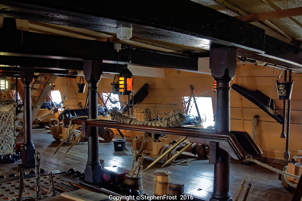 A scene from a lower deck of HMS Victory in Portsmouth, England. HMS Victory is a 104-gun ship of the line of the Royal Navy, launched in 1765. She was Lord Nelson's flagship at the Battle of Trafalgar in 1805.