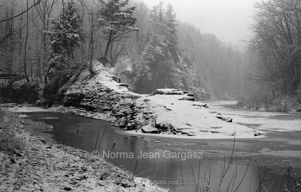 The Vermilion River meanders through the snow covered Peasley Hollow in Vermilion, Ohio.