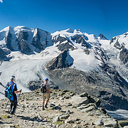 """From Diavolezza cable car station, admire tremendous views of the icy Bernina Range, in Switzerland, Europe. Above Pers Glacier rise Piz Palü (3900 m on left), Piz Zupò (3996 m), and Piz Bernina (4049 m on right), in the Swiss canton of Graubünden (or Grisons / Grigioni / Grischun). If not afraid of heights at Diavolezza, don't miss the magnificent hike to rocky Munt Pers (gaining 265 meters over just 4 km round trip). The Swiss valley of Engadine translates as the """"garden of the En (or Inn) River"""" (Engadin in German, Engiadina in Romansh, Engadina in Italian) and is part of the Danube basin. This image was stitched from multiple overlapping photos."""