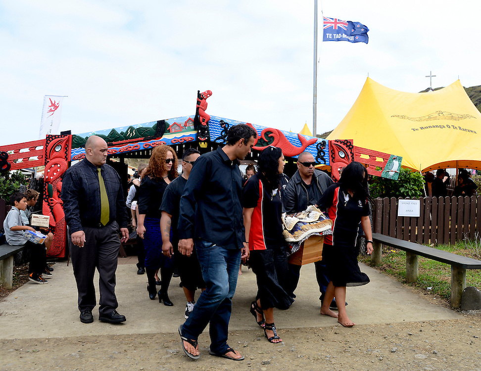 Mourners carry the casket of artist Ralph Hotere from the meeting house on Matihetihe Marae, Mitimiti, North Hokianga, New Zealand, Monday, March 04, 2013. Credit: SNPA / Malcolm Pullman