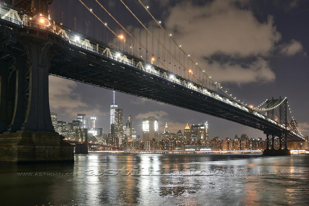 View of the Manhattan under Manhattan Bridge in late evening.