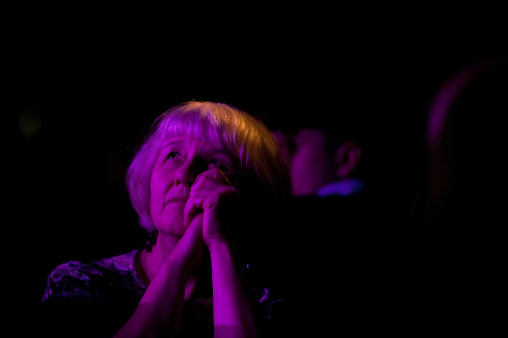 A woman in the crowd listens to tenor Joseph Calleja performing at Le Poisson Rouge on October 24, 2011.