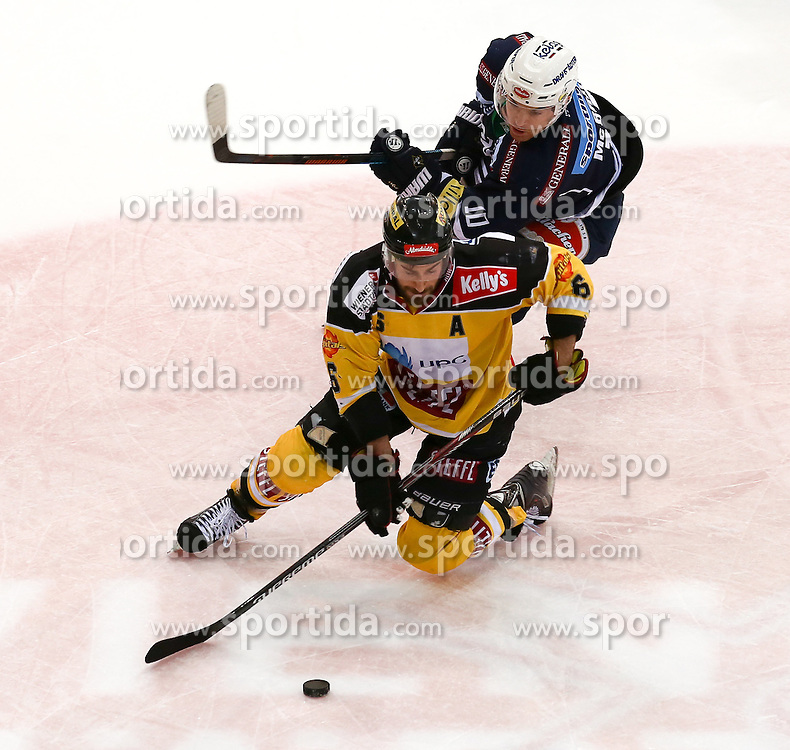 28.12.2015, Albert Schultz Halle, Wien, AUT, EBEL, UPC Vienna Capitals vs EC VSV, 36. Runde, im Bild Rafael Rotter (Vienna Capitals) und Brock Mcbride (EC VSV) // during the Erste Bank Icehockey League 36th round match between UPC Vienna Capitals and EC VSV at the Albert Schultz Halle in Vienna, Austria on 2015/12/28. EXPA Pictures © 2015, PhotoCredit: EXPA/ Alexander Forst