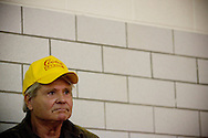 "Actor and former Congressman Ben ""Cooter"" Jones listens as U.S. Democratic presidential candidate John Edwards speaks to potential voters during a campaign stop in Exira, Iowa, October 16, 2007."