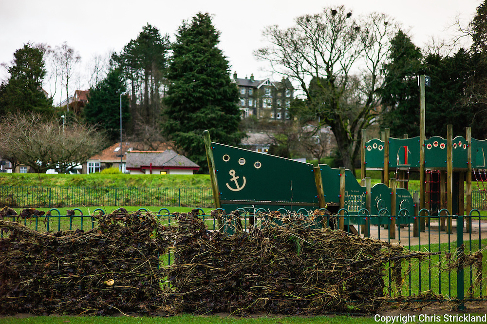 Peebles, Scotland, UK. 31st December 2015. Debris washed up from the River Tweed on a childrens play park fence in the town of Peebles after Storm Frank.