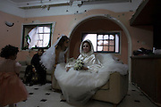 Palestinian bride Anaan El Harazen ,24, sits in the damaged salon of her family's home as she waits to pose for pictures with family members before her groom comes to take her away for their wedding in the Shijaiyah neighborhood of eastern Gaza City November 4,2014. The family's home was severely damaged during last summer's war between Israel and the Hama-controlled Gaza Strip. (Photo by Heidi Levine/Sipa Press).