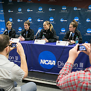 03/20/2014- Stevens Point, Wisc. - Tufts head coach Carla Berube, alongside, from left, Tufts guard Caitlin McClure, A14, Tufts forward Ali Rocchi, A14, and Tufts guard Liz Moynihan, A14, speaks during the press conference for the NCAA Division III Women's Final Four on Mar. 20, 2014. (Kelvin Ma/Tufts University)