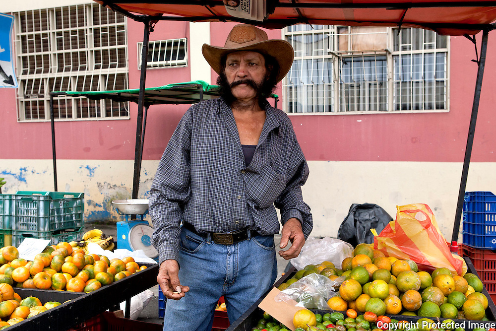Raul Delgado from acoca? sells maderines, oranges and squash among other things at the feria in Plaza de Viquez.