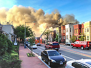 The smoke pours out of Frager's Hardware. The view from 11th St. SE.
