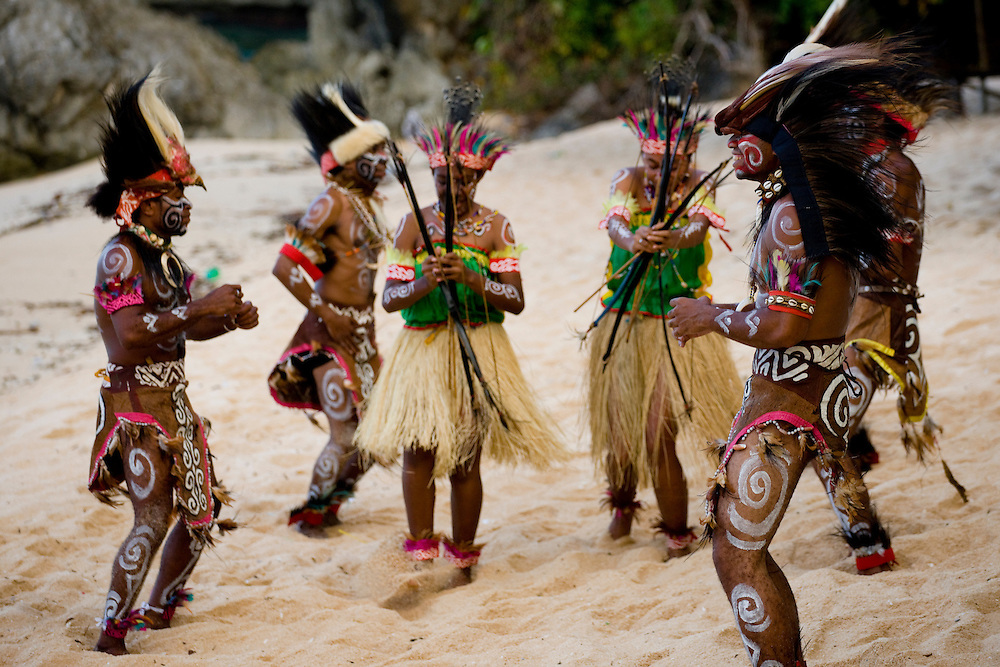 """The """"Mahai Mamuna"""" war dance performed on a  beach in Jayapura, Papua, Indonesia, Sept. 15, 2008. The dance is originally from the village of Yapen on the island of Serui and symbolizes a war between the Menawi and Ambai tribes..Daniel Beltra/Greenpeace"""