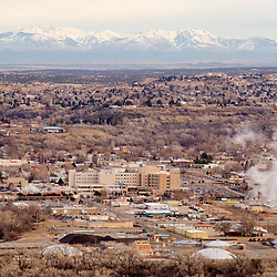 A light haze hovers over Farmington, New Mexico and the San Juan Mountains of Colorado. The haze is often attributed to the Four Corners Power Plant and San Juan Generating Station, two coal fired power plants that operate near by.