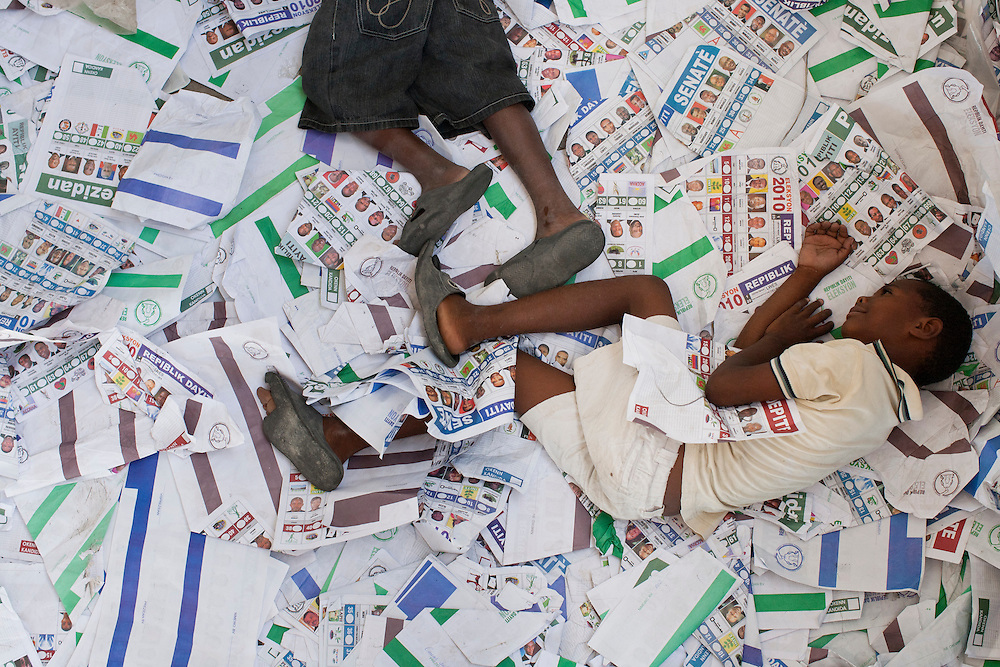 Children play in ballots at a polling station that had been ransacked on the previous day during presidential and legislative elections in Port-au-Prince, Haiti.