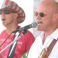 Dave Hervey, left, and Robert Beauchene of Blivet perform Sunday July 13, 2014 during Boogie in the Park at Kure Beach, N.C. (Jason A. Frizzelle)