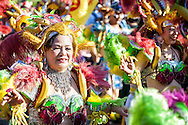 Colorful costumes worn by middle aged women at the Dream Parade.