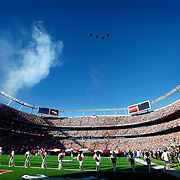 SHOT 1/8/12 3:37:08 PM - Fighter jets pass over the field in formation as the Denver Broncos prepare to face off against the Pittsburgh Steelers during their AFC Wildcard game at Sports Authority Field at Mile High on Sunday January 8, 2012.  (Photo by Marc Piscotty / © 2012)