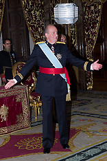 File photo - King Juan Carlos hands his crown to Felipe
