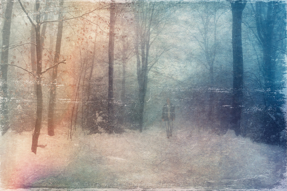 Man taking a walk through a wintry forest. Texturized photograph