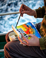Grace working on a water color painting in the late afternoon sun. Aft deck of the MV World Odyssey crossing the Pacific Ocean. Semester at Sea, 2016 Spring Semester Voyage. Day 2 of 102. Image taken with a Leica T camera and 23 mm f/2 lens (ISO 100, 23 mm, f/2, 1/100 sec).