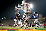 Cordova Lancers Alvin Banks (16), punts the ball from his own end zone during the third quarter of the Sac-Joaquin Section Division I football playoff game between the Christian Brothers Falcons and Cordova Lancers at Hughes Stadium,  Friday Nov 11, 2016.<br /> photo by Brian Baer