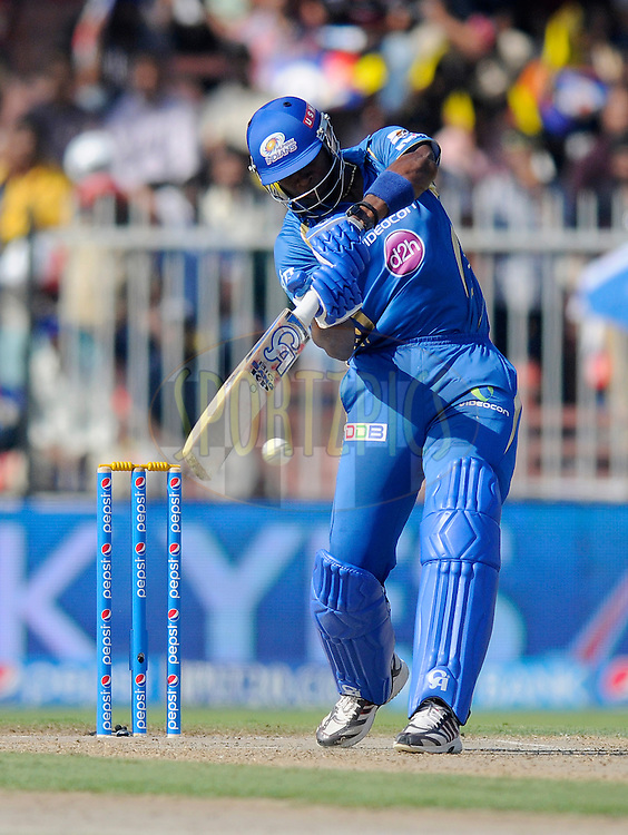 Kieron Pollard of the Mumbai Indians bats during match 16 of the Pepsi Indian Premier League 2014 between the Delhi Daredevils and the Mumbai Indians held at the Sharjah Cricket Stadium, Sharjah, United Arab Emirates on the 27th April 2014<br /> <br /> Photo by Pal Pillai / IPL / SPORTZPICS