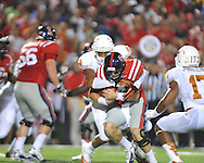 Ole Miss quarterback Bo Wallace (14) is sacked by Texas' Jackson Jeffcoat (44) at Vaught-Hemingway Stadium in Oxford, Miss. on Saturday, September 15, 2012. Texas won 66-21. Ole Miss falls to 2-1.