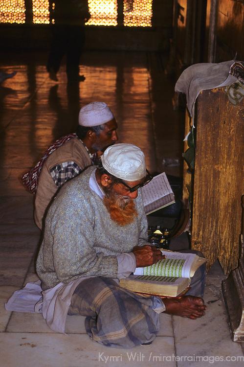 Asia, India, Uttar Pradesh, Fatehpur Sikri. Two men reading at the Tomb of Salim Chisti in Fatehpur Sikri.