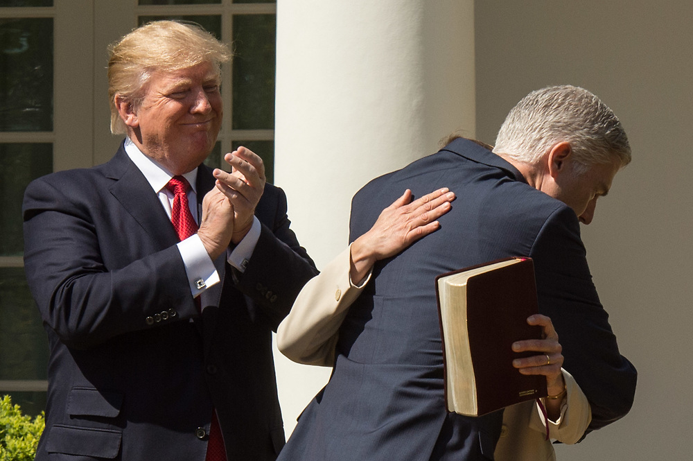 U.S. President Donald J. Trump applauds Asscociate Supreme Court Justice Neil Gorsuch during a ceremony in the Rose Garden of the White House. Gorsuch replaces the seat vacated by Antonin Scalia when he died.