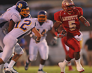Lafayette High's Demarkous Dennis (5) runs 46 yards for a touchdown past Oxford High's Robert Liggins (1) and Oxford High's Ethan Holmes (12) at William L. Buford Stadium in Oxford, Miss. on Friday, September 2, 2011. Lafayette won 40-12