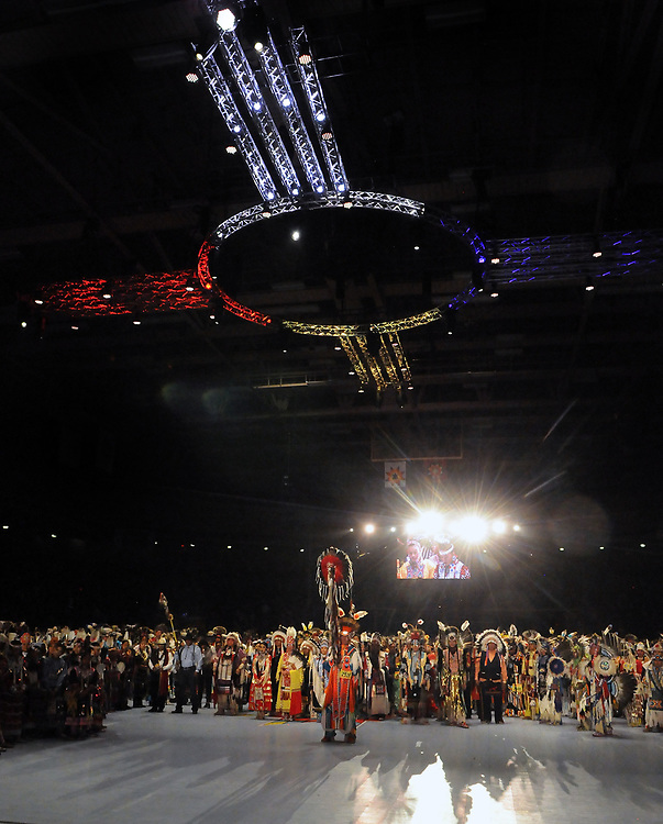 jt042817w/a sec/jim thompson/ Terrance Goodwill of Saskatchewan, Canada carries the Eagle Staff for the Grand Entrance of the 2017 Gathering of Nations Pow-Pow held at Tingley Coliseum under the red,whit and blue Zia symbol.   Friday April 28, 2017. (Jim Thompson/Albuquerque Journal)