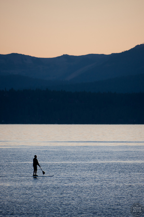 """Paddle Boarder on Lake Tahoe 1"" - This stand up paddle boarder was photographed at sunset from Speedboat Beach, Lake Tahoe."