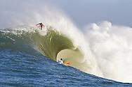 "Evan Slater (top), drops into a  huge wave over Darryl ""Flea"" Virostko during the first heat of the Mavericks surf contest Saturday, Feb. 13, 2010. in Half Moon Bay, California"