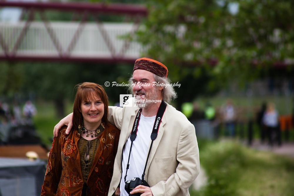A man and woman having fun at Strawberry Fair, Cambridge