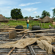 Elevated grain stores such as this one, seen in Kudo village in Eastern Equatoria on 8 August 2014, shoud ordinarily be full of sorghum following the harvest. This year, however, due to a combination of drought in some parts of the country, the ravages of pests in others, and instability caused by war, many South Sudanese are facing acute food shortages and possibly famine.