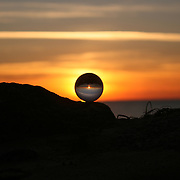 Crystal ball on a rock on a Jekyll Island beach at sunrise, sunset
