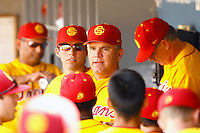 13 March 2011: NCAA Pac-10 college UCLA-USC sports rivalry baseball teams met in a non-conference game at Dodger Stadium as part of the Dodgertown Classic.  USC Trojans defeated the UCLA Bruins 2-0 during an afternoon weekend game inside the MLB stadium.  Assistant Coach Doyle Wilson speaks to players in the dugout.