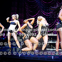 Danity Kane performing at The Hammerstein Ballroom on May 28, 2008. .Shannon Rae Bex - blonde -caucasion with white top..Aundrea Aurora Fimbres - brunette - caucasian with black top..Aubrey Morgan O'Day - blonde - caucasian with black top with white stripes.Dawn Angelique Richard- long hair - African Am. with white top and long wavy hair..Wanita Denise Woodgette - shorter hair - African Am. with Black top.