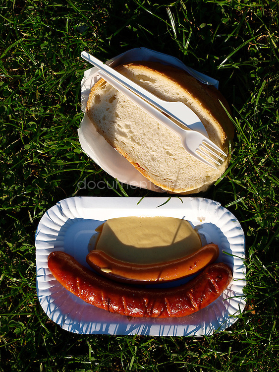 Sausages and bread in the park, Budapest, Hungary.