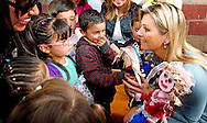 5-3-2014 BOGOTA - COLOMBIA - Dutch Queen MAxima of the Netherlands visit with the First Lady van Colombia, María Clemencia Rodríguez Múnera a day care centre for children 0-5 years. COPYRIGHT ROBIN UTRECHT