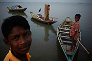 The northern shore of Bhola.?This area in the south of Bangladesh has been called ground zero of climate-change due to heavy river and ocean erosion. The lowlying area is also hugely affected by cyclones and rising sea-levels...By the Mouth of Ganges, at the Bay of Bengal is the Island of Bhola. This home of about two million people is considered to be ground zero of climate change. Half the island has disappeared in the past 40 years, and according to scientists the pace is not going to slow down. People pack up and leave as the water get closer. Some to a nearby embankment, while those with enough money move further inland, but for most life move on until the inevitable. It's always about survival for the people in one of the worlds poorest countries...Photo by: Eivind H. Natvig/MOMENT