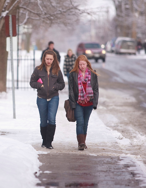 Woodstock, ONT.; December 9, 2010-- High school students Rachel Moodie, 14, left, and Liv Marsh, 15 brave the wintery weather in downtown Woodstock, Ontario December 9, 2010 as the town reacts to the lifting a publication ban in the case of Terry-Lynne McClintic who pleaded guilty in April, 2010 to first degree murder in the death of  8 year old Victoria Stafford. The verdict and all proceedings were under a sweeping publication ban which was appealed by the media to the Supreme Court.<br /> <br /> (GEOFF ROBINS/ Postmedia News)