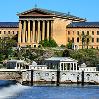 Museum of Art, Fairmount Water Works and Schuylkill River in Philadelphia, Pennsylvania<br /> The Philadelphia Museum of Art opened in 1876 as part of the country&rsquo;s centennial celebration. On the 72nd step are the cast footprints where Rocky Balboa raised his arms in triumph. On the backside of this Greek Revival building is the Schuylkill River. It flows 135 miles through Pennsylvania. In the foreground is the Fairmount Water Works. The public utility was built between 1812 and 1815. The original version supplied Philadelphia with fresh water in response to the yellow fever epidemic of the late 1700s.